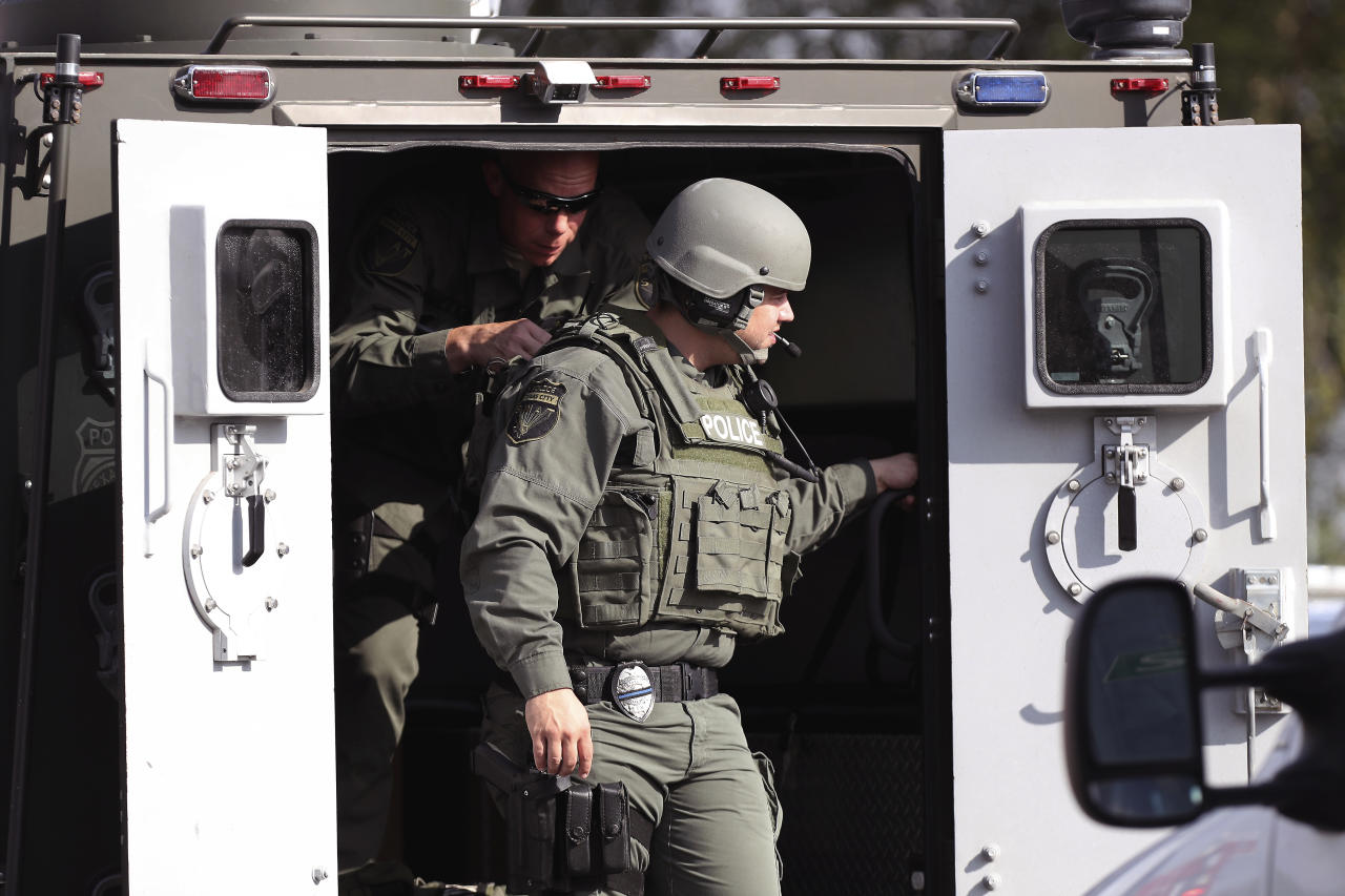 <p>Law enforcement officers respond to an active shooter in front of Santa  Fe