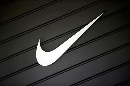 FILE PHOTO: The logo of Nike (NKE) is seen in Los Angeles, California, U.S., April 12, 2016.  REUTERS/Lucy Nicholson/File Photo
