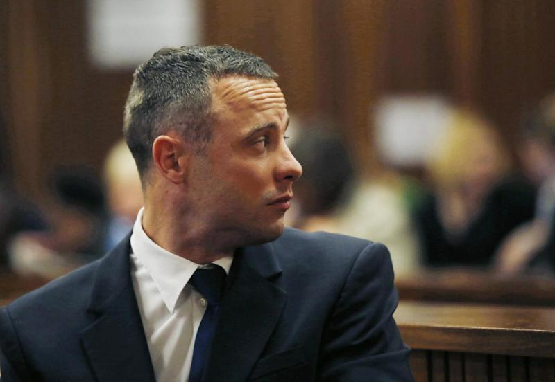 Oscar Pistorius looks back in a courtroom at the high court in Pretoria, South Africa, Tuesday, May 6, 2014. A man who lives next to the house where Pistorius fatally shot his girlfriend has testified at the athlete's murder trial about the night of the killing, saying he heard a man crying loudly and that he called the security of the housing estate for help. (AP Photo/Mike Hutchings, Pool)