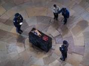 U.S. Capitol Police officer Brian D. Sicknick lies in honor, in Washington