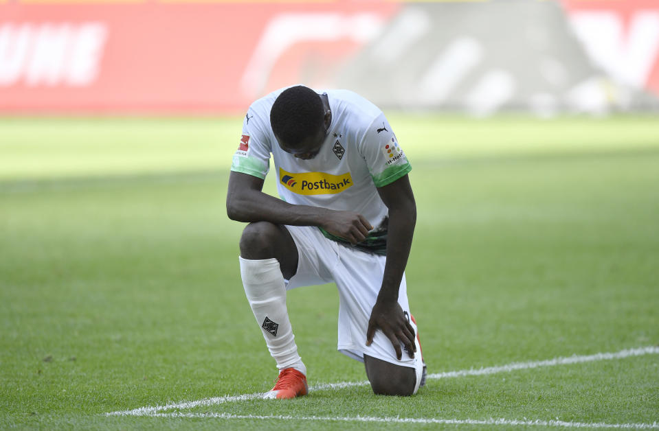 Moenchengladbach's Marcus Thuram reacts after scoring his side's second goal during the German Bundesliga soccer match between Borussia Moenchengladbach and Union Berlin in Moenchengladbach, Germany, Sunday, May 31, 2020. The German Bundesliga becomes the world's first major soccer league to resume after a two-month suspension because of the coronavirus pandemic. (AP Photo/Martin Meissner, Pool)