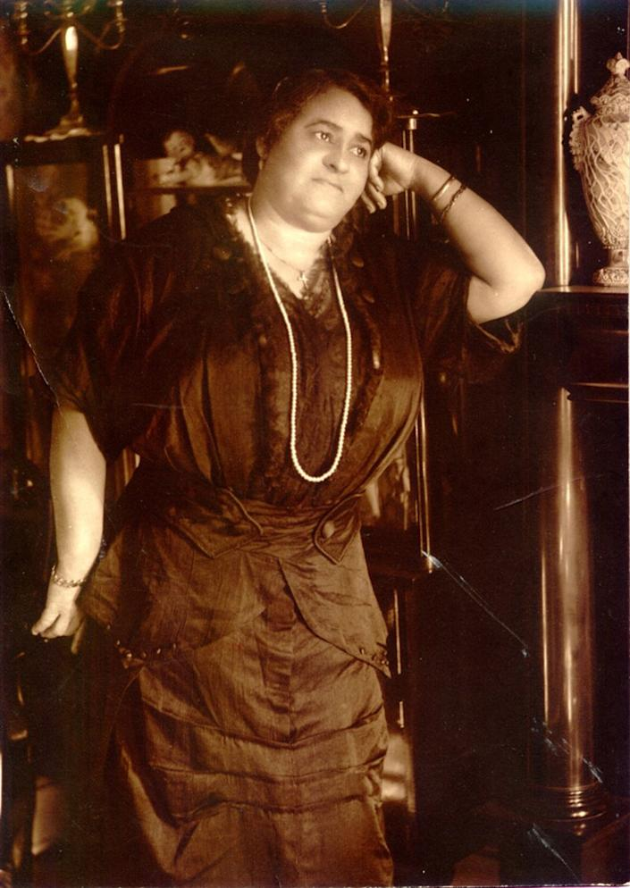 Maggie L. Walker, standing in the parlor of her home. | National Park Service Museum Collections