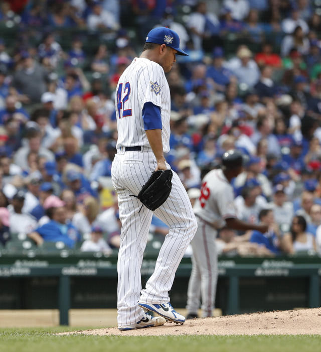 Chicago Cubs' Jose Quintana reacts after giving up a run against the Atlanta Braves during the fifth inning of a baseball game, Monday, May 14, 2018, in Chicago. (AP Photo/Kamil Krzaczynski)
