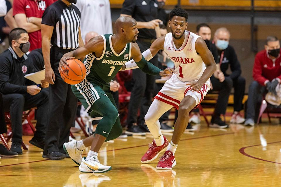 Michigan State Spartans guard Joshua Langford dribbles against Indiana Hoosiers guard Al Durham in the first half Feb. 20, 2021 in Bloomington, Ind.