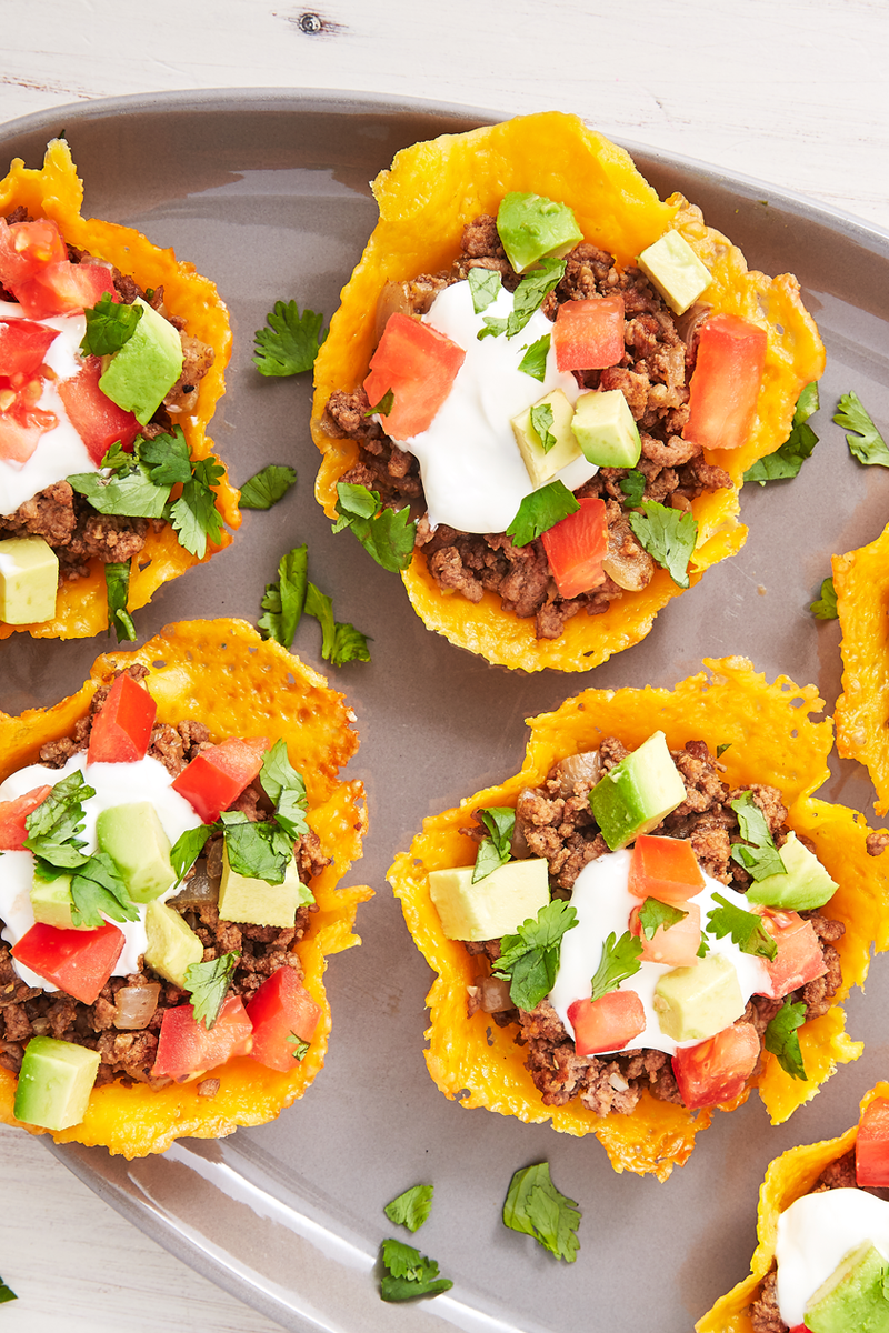 """<p><a href=""""https://www.delish.com/uk/cooking/recipes/a30291829/keto-taco-casserole-recipe/"""" rel=""""nofollow noopener"""" target=""""_blank"""" data-ylk=""""slk:Taco"""" class=""""link rapid-noclick-resp"""">Taco</a> shells made out of cheese is the ultimate Keto hack. These cups are so easy to make! Cutting parchment paper into individual squares makes transferring the cheese to the muffin tin easier, but you can also carefully peel the cheese off with your hands or use a metal spatula to lift them up. Be sure to give them a minute to cool before lifting! </p><p>Get the <a href=""""https://www.delish.com/uk/cooking/recipes/a30712335/keto-taco-cups-recipe/"""" rel=""""nofollow noopener"""" target=""""_blank"""" data-ylk=""""slk:Keto Tacos"""" class=""""link rapid-noclick-resp"""">Keto Tacos</a> recipe.</p>"""