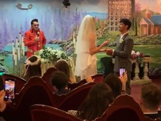 An Elvis Presley impersonator officiates as Sophie Turner and Joe Jonas place wedding rings on each other's fingers (Instagram/Diplo)