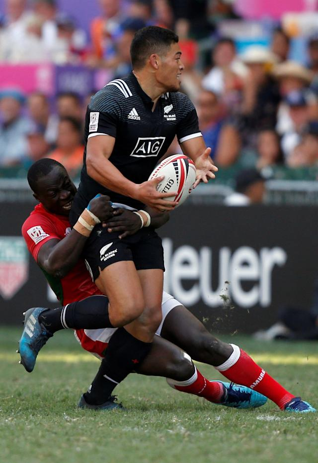 Rugby Union - Kenya v New Zealand - World Rugby Sevens Series - Hong Kong Stadium, Hong Kong, China - April 8, 2018 - New Zealand's Tone Ng Shiu is tackled by Kenya's Jeffrey Oluoch. REUTERS/Bobby Yip