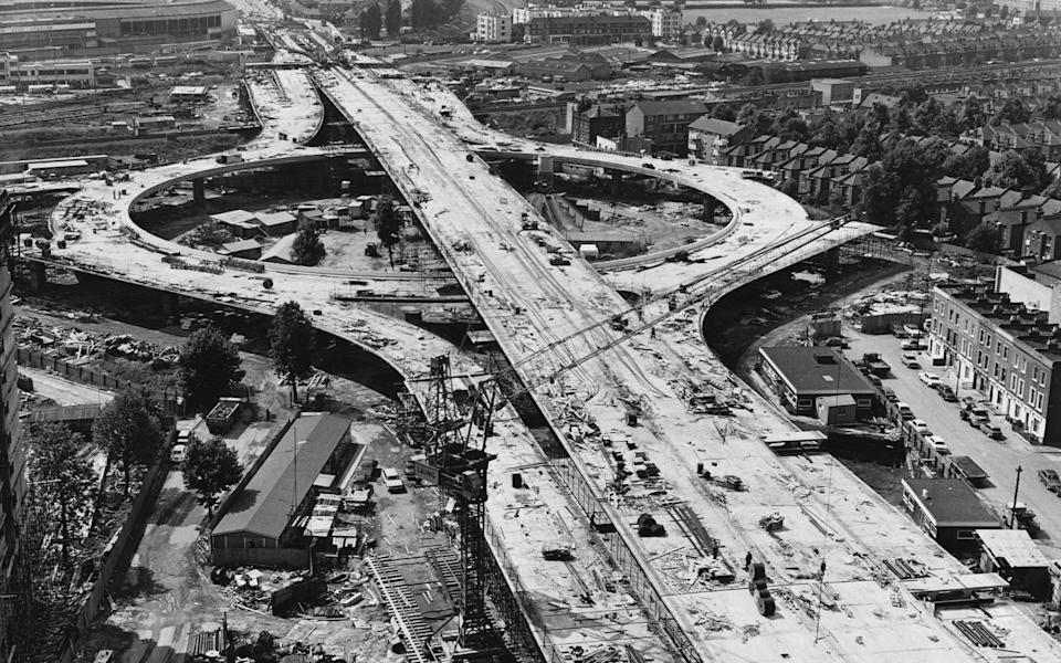 Building work in progress on three levels at the Latimer Road interchange with the Western Avenue extension at its junction with the proposed West Cross Route. This section of elevated motorway will link Marylebone Road with Western Avenue at Westway, near White City Stadium (top left). (Photo by © Hulton-Deutsch Collection/CORBIS/Corbis via Getty Images)  - Getty