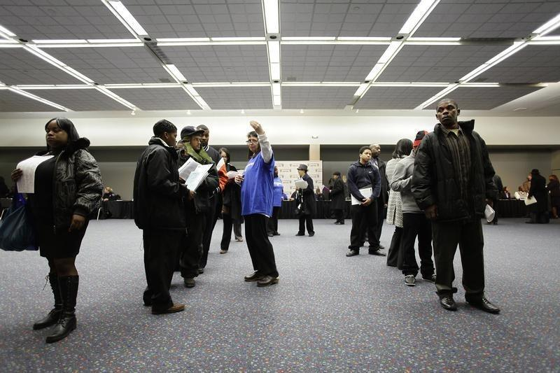 People attend a job fair in Detroit