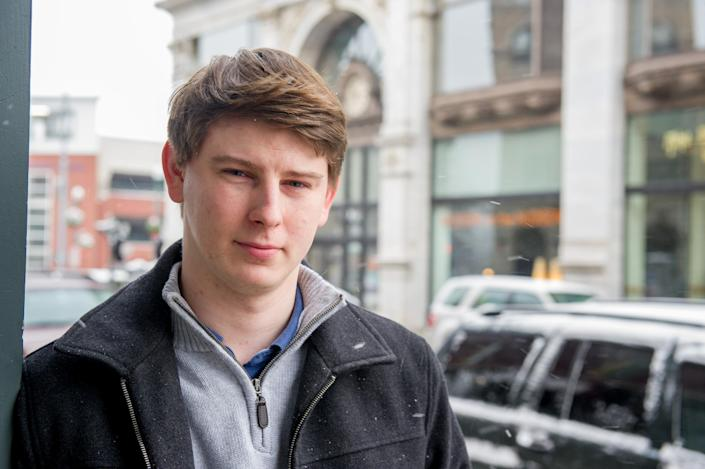 """Bart Murawski, 27 poses outside a coffee shop Tuesday, Nov. 26, 2013, in Troy, N.Y. You can take our word for it: Americans don't trust each other anymore. An AP-GfK poll conducted last month found that Americans are suspicious of each other in everyday encounters. Less than a third expressed a lot of trust in clerks who swipe their credit cards, drivers on the road, or people they meet when traveling. """"I'm leery of everybody,"""" said Murawski. """"Caution is always a factor."""" (AP Photo/Shannon DeCelle)"""