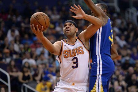 Apr 8, 2018; Phoenix, AZ, USA; Phoenix Suns forward Jared Dudley (3) goes to the basket ahead of Golden State Warriors forward Kevin Durant (35) during the second quarter at Talking Stick Resort Arena. Mandatory Credit: Orlando Ramirez-USA TODAY Sports