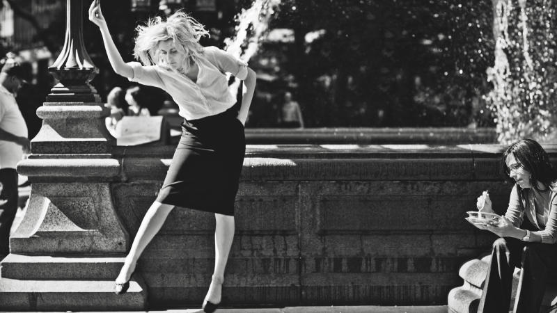 "This undated publicity photo released by the Independent Film Channel shows Greta Gerwig, left, as Frances dancing in front of fountain in a scene from the film, ""Frances Ha."" (AP Photo/IFC)"