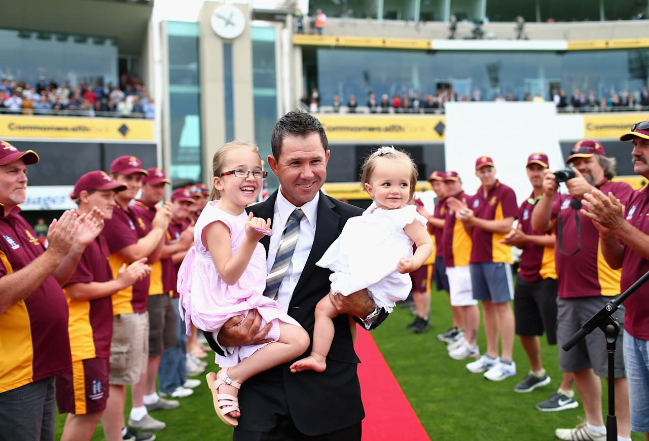 HOBART, AUSTRALIA - DECEMBER 14:  Former Australian cricketer Ricky Ponting is presented to the crowd after a farewell lap with his daughters Emmy and Matisse during day one of the First Test match between Australia and Sri Lanka at Blundstone Arena on December 14, 2012 in Hobart, Australia.  (Photo by Ryan Pierse/Getty Images)