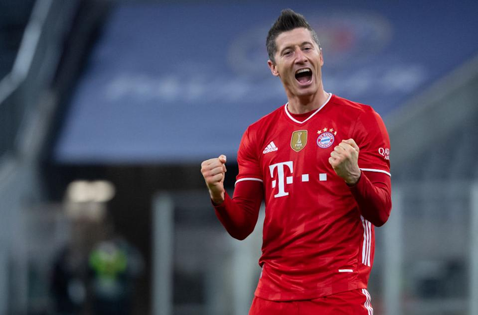06 March 2021, Bavaria, Munich: Football: Bundesliga, Bayern Munich - Borussia Dortmund, Matchday 24 at Allianz Arena. Robert Lewandowski of Munich celebrates his goal to make it 4:2. Photo: Sven Hoppe/dpa - IMPORTANT NOTE: In accordance with the regulations of the DFL Deutsche Fußball Liga and/or the DFB Deutscher Fußball-Bund, it is prohibited to use or have used photographs taken in the stadium and/or of the match in the form of sequence pictures and/or video-like photo series. (Photo by Sven Hoppe/picture alliance via Getty Images)