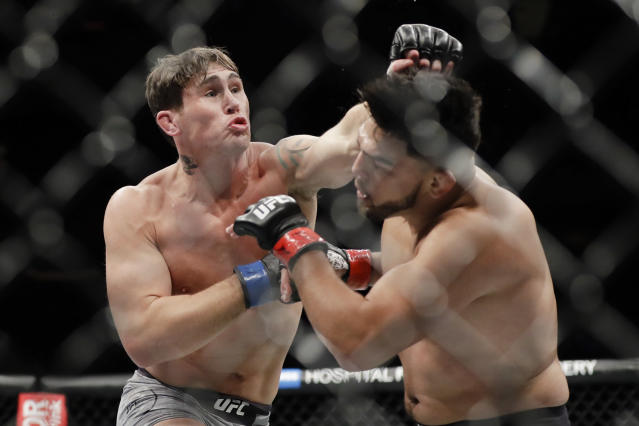 Britain's Darren Till, left, punches Kelvin Gastelum during the second round of a middleweight mixed martial arts bout at UFC 244 on Saturday, Nov. 2, 2019, in New York. Till won the fight. (AP Photo/Frank Franklin II)