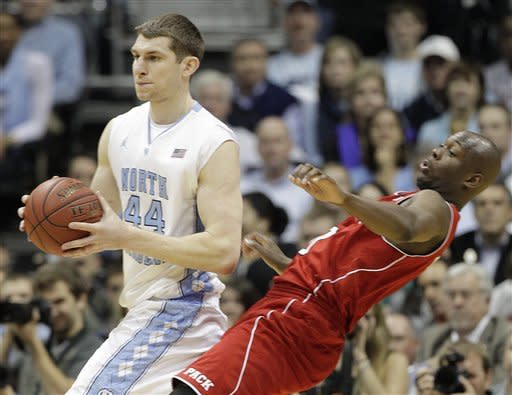 North Carolina forward Tyler Zeller (44) works against North Carolina State center DeShawn Painter (0) during the second half of an NCAA college basketball game in the semifinals of the Atlantic Coast Conference tournament, Saturday, March 10, 2012, in Atlanta. (AP Photo/Chuck Burton)