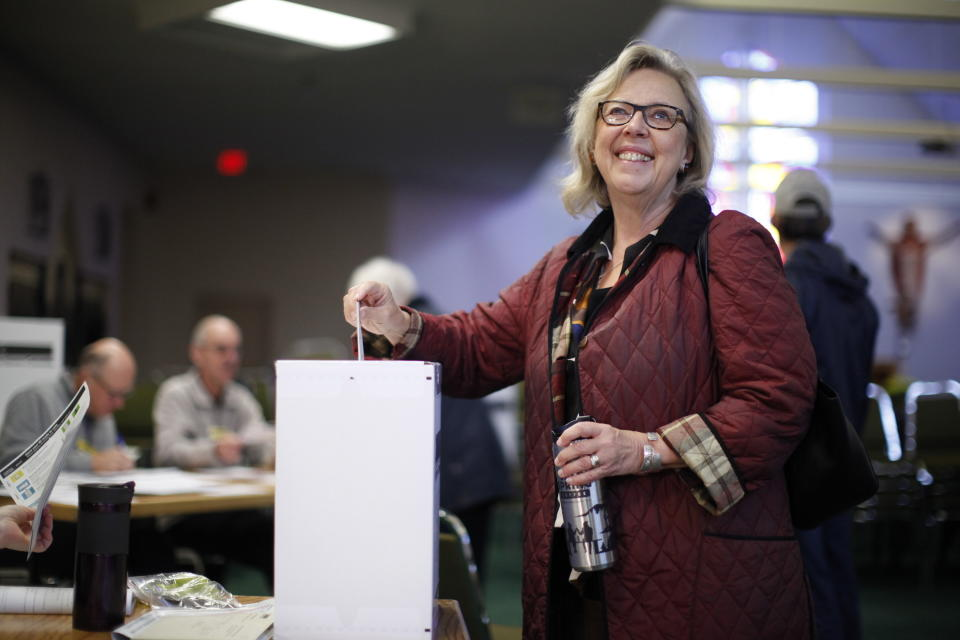 Green Party Leader Elizabeth May casts her vote at St. Elizabeth's Parish while in Sidney, British Columbia Monday, Oct. 21, 2019. (Chad Hipolito/The Canadian Press via AP)