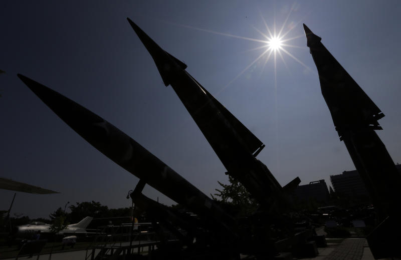 South Korean mock missiles are silhouetted at the Korea War Memorial Museum in Seoul, South Korea, Sunday, Oct. 7, 2012. South Korea said the U.S. has agreed to allow it to develop longer-range missiles that could strike all of North Korea. (AP Photo/Lee Jin-man)