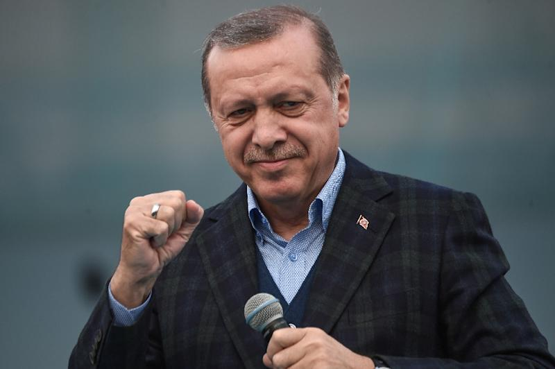 """Turkish President Recep Tayyip Erdogan gestures as he delivers a speech on April 8, 2017 during a campaign rally for the """"yes"""" vote in a constitutional referendum in Istanbul"""