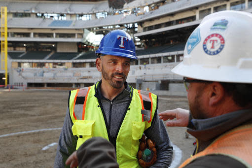 Texas Rangers manager Chris Woodward, left, listens during a tour of the under construction baseball field at the new Rangers stadium in Arlington, Texas, Wednesday, Dec. 4, 2019. (AP Photo/LM Otero)