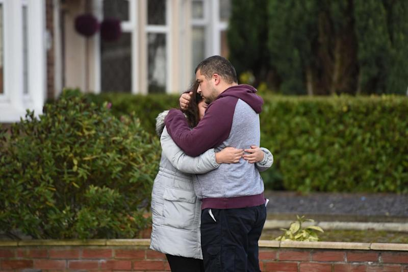 Reese Platt-May, the father of brothers Corey and Casper, hugs his sister Tia Fletcher close to the scene where the boys, aged six and two, were killed in a hit-and-run collision in Coventry (PA)