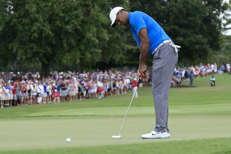 Tiger Woods putts for birdie on the third hole during the third round of the Tour Championship golf tournament Saturday, Sept. 22, 2018, in Atlanta. (AP Photo/John Amis)