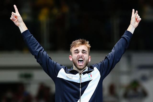 <p>Gold medalist Daniele Garozzo of Italy celebrates on the podium during the medal ceremony for the Men's Individual Foil Final on Day 2 of the Rio 2016 Olympic Games at Carioca Arena 3 on August 7, 2016 in Rio de Janeiro, Brazil. (Photo by Alex Livesey/Getty Images) </p>