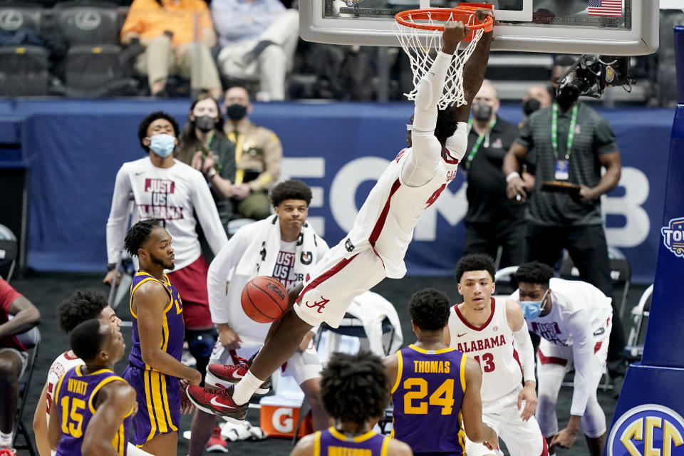 Alabama's Juwan Gary (4) dunks the ball against LSU during the second half of the championship game at the NCAA college basketball Southeastern Conference Tournament Sunday, March 14, 2021, in Nashville, Tenn. (AP Photo/Mark Humphrey)