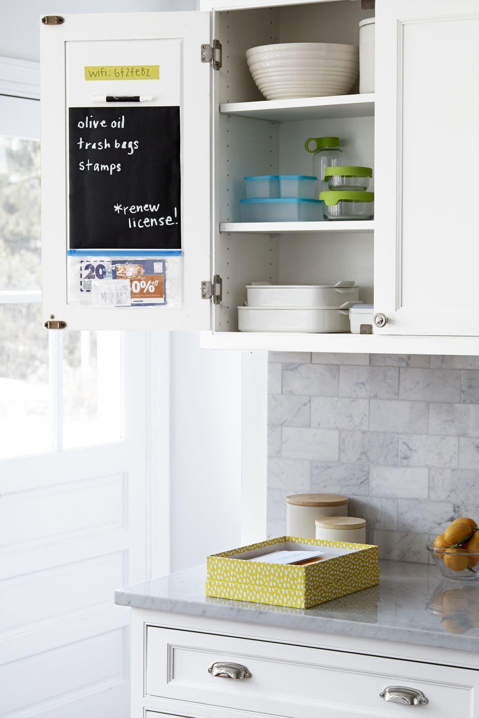 """<p>Turn the inside of a cabinet door into an undercover organization station that stores important info like the <a href=""""https://www.womansday.com/life/travel-tips/a56554/airport-wifi/"""" rel=""""nofollow noopener"""" target=""""_blank"""" data-ylk=""""slk:WiFi password"""" class=""""link rapid-noclick-resp"""">WiFi password</a>, memos, and coupons. Create your own memo board by trimming chalkboard vinyl to size and position at eye level.</p><p><strong><a class=""""link rapid-noclick-resp"""" href=""""https://www.amazon.com/Cricut-2002362-Vinyl-Chalkboard/dp/B00LJV1JLI?tag=syn-yahoo-20&ascsubtag=%5Bartid%7C10070.g.3310%5Bsrc%7Cyahoo-us"""" rel=""""nofollow noopener"""" target=""""_blank"""" data-ylk=""""slk:SHOP CHALKBOARD VINYL"""">SHOP CHALKBOARD VINYL</a></strong></p>"""