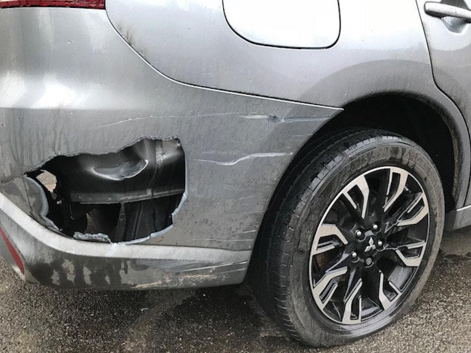 The crash left a huge dent hole in Lindsey Mannion's car (Picture: SWNS)