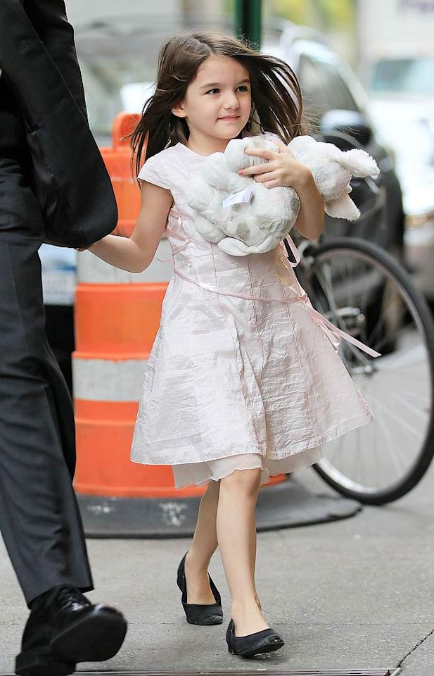 """Suri Cruise is """"currently penning her own children's book,"""" reports In Touch. The mag reveals, """"Not only is she writing the book, she's also working on all the illustrations,"""" and Tom Cruise and Katie Holmes will make sure it's published. For what the book's about and when it's expected to go on sale, see what a family friend leaks to <a target=""""_blank"""" href=""""http://www.gossipcop.com/suri-cruise-writing-childrens-book-illustrations-author/"""">Gossip Cop.</a> (11/10/2011)"""