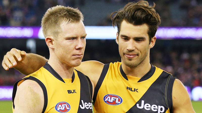 Pictured here, Richmond teammates Jack Riewoldt and Alex Rance embrace after a match.