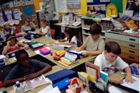 """<p>Second grade students reading and writing in class at their year-round school in San Diego.</p><p><strong>RELATED: </strong><a href=""""https://www.goodhousekeeping.com/health/wellness/a28185184/college-depression-anxiety-tips/"""" rel=""""nofollow noopener"""" target=""""_blank"""" data-ylk=""""slk:College Depression and Anxiety Are Serious — Here's How to Help Yourself or a Friend"""" class=""""link rapid-noclick-resp"""">College Depression and Anxiety Are Serious — Here's How to Help Yourself or a Friend</a><br></p>"""