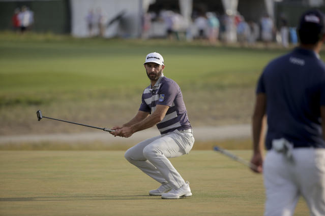 Dustin Johnson reacts after missing a putt on the 15th green during the third round of the U.S. Open. (AP)