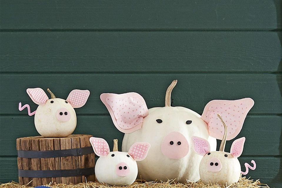"""<p>This adorable piglet is kind of a <em>pig</em> deal. <strong><br></strong><strong><br>Make the pumpkin:</strong> Download and trace our <a href=""""https://hmg-prod.s3.amazonaws.com/files/pumpkin-carving-template-pig-piglets-1018-1536169821.pdf?tag=syn-yahoo-20&ascsubtag=%5Bartid%7C10050.g.28437255%5Bsrc%7Cyahoo-us"""" rel=""""nofollow noopener"""" target=""""_blank"""" data-ylk=""""slk:ears and nose templates"""" class=""""link rapid-noclick-resp"""">ears and nose templates</a> on <a href=""""https://www.amazon.com/Acrylic-Felt-Sheet-12-Light/dp/B003O9I2HW?tag=syn-yahoo-20&ascsubtag=%5Bartid%7C10050.g.28437255%5Bsrc%7Cyahoo-us"""" rel=""""nofollow noopener"""" target=""""_blank"""" data-ylk=""""slk:pink felt"""" class=""""link rapid-noclick-resp"""">pink felt</a>, then cut out. For the inner ear pieces (they should be slightly smaller than the felt), cut from <a href=""""https://go.redirectingat.com?id=74968X1596630&url=https%3A%2F%2Fwww.michaels.com%2Flight-pink-dots-paper-by-recollections%2F10125128.html&sref=https%3A%2F%2Fwww.countryliving.com%2Fdiy-crafts%2Fg28437255%2Fpumpkin-faces-ideas%2F"""" rel=""""nofollow noopener"""" target=""""_blank"""" data-ylk=""""slk:patterned pink craft paper"""" class=""""link rapid-noclick-resp"""">patterned pink craft paper</a>. Use craft glue to attach the paper to the felt and hot-glue the ears and noses to the pumpkins. Next, paint two pumpkin seeds with black craft paint and hot-glue them for eyes for mama and small black buttons for mama's nostrils and piglets' eyes and nostrils. Finally, twist pink pipe cleaners in coils and hot-glue one to the back of each pumpkin as makeshift tails. </p>"""