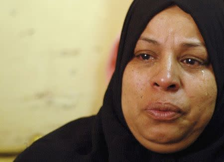 Afafa Abdel Magid, 49, mother of Samir, a 10-year-old Egyptian boy who died during clashes between supporters and opponents of deposed Islamist President Mohamed Mursi, cries during an interview with Reuters in their house in Suez May 25, 2014. REUTERS/Stringer
