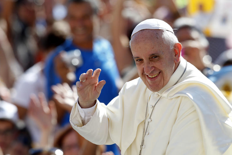 Pope Francis waves to faithful as he arrives for his weekly general audience in St. Peter's square at the Vatican, Wednesday, Sept. 4, 2013. (AP Photo/Riccardo De Luca)