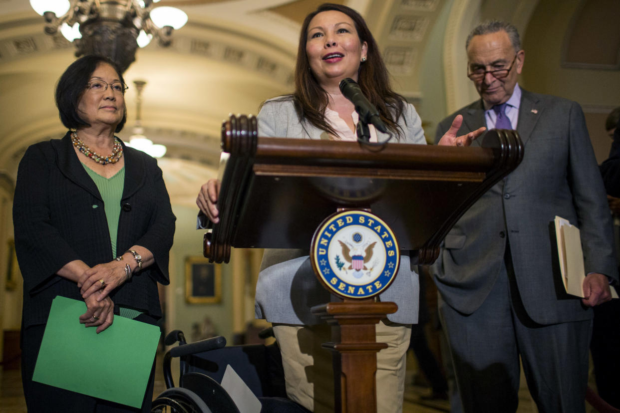 Sen. Tammy Duckworth, D-Ill., speaks during a news conference on Capitol Hill in August in Washington, D.C. Sen. Mazie Hirono, D-Hawaii and Senate Minority Leader Chuck Schumer, D-N.Y., look on. (Photo: Zach Gibson/Getty Images)