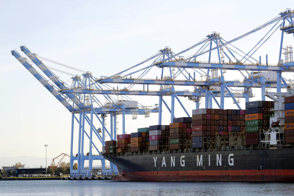 "In this Nov. 4, 2019, file photo cargo cranes are used to take containers off of a Yang Ming Marine Transport Corporation boat at the Port of Tacoma in Tacoma, Wash. President Donald Trump says he ""will make a decision very soon'' about whether to impose tariffs on imported cars and auto parts. (AP Photo/Ted S. Warren, File)"