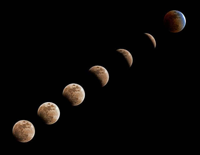 <p>Phases of a lunar eclipse during a blue moon and a supermoon in Vladivostok, Russia, Jan. 31, 2018. (Photo: Yuri Smityuk\TASS via Getty Images) </p>