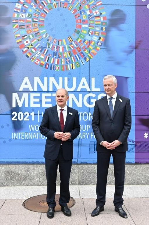 French Finance Minister Bruno Le Maire (right) speaks with German Finance Minister Olaf Scholz (left) outside IMF headquarters in Washington (AFP/Jim WATSON)