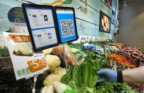 A merchant quick response (QR) code and payment instructions for Ant Financial Services Group's Alipay, are displayed at a stall inside Po Tat Market in Sau Mau Ping on 18 Nove,ber 2017. Photo: Edmond So