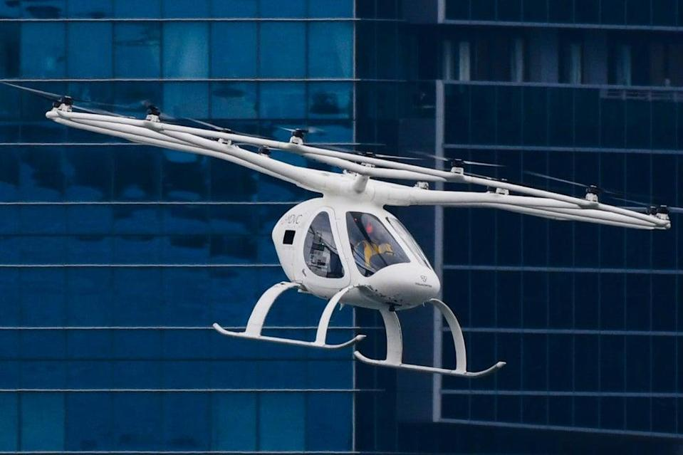 A Volocopter unmanned air taxi transport flies over Marina Bay during test flight with a safety pilot at the 26th Intelligent Transport Systems World Congress (ITSWC) in Singapore on October 22, 2019. (AFP via Getty Images)