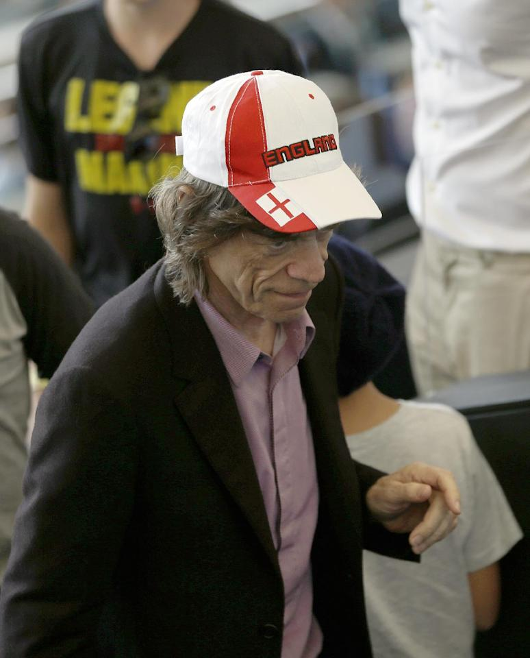 Mick Jagger attends the World Cup final soccer match between Germany and Argentina at the Maracana Stadium in Rio de Janeiro, Brazil, Sunday, July 13, 2014. (AP Photo/Themba Hadebe)