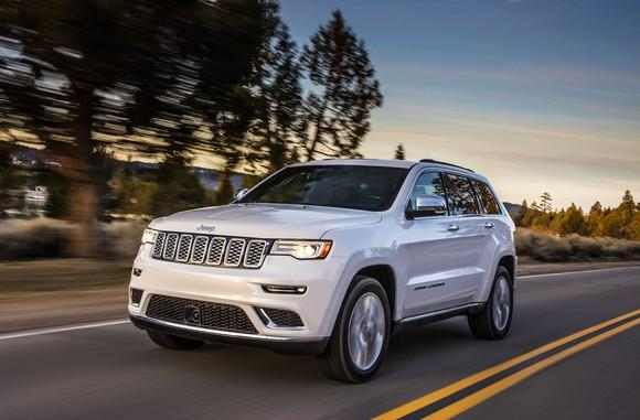 A White Jeep Grand Cherokee Large Crossover Suv On Country Road