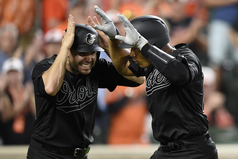 Baltimore Orioles' Pedro Severino, right, celebrates with Renato Nunez after hitting a grand slam against the Tampa Bay Rays during the third inning of a baseball game Saturday, Aug. 24, 2019, in Baltimore. (AP Photo/Gail Burton)