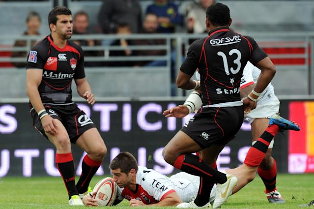 Toulon French scrum-half Sebastien Tillous-Borde scores a try during the French Top 14 rugby union match Lyon vs. Toulon on May 12, 2012 in Lyon. AFP PHOTO PHILIPPE MERLEPHILIPPE MERLE/AFP/GettyImages