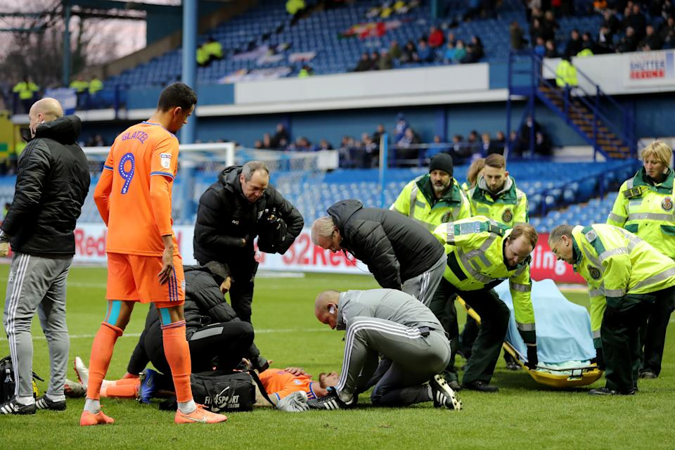 Cardiff City's Joe Bennett requires medical assistance as he lays injured