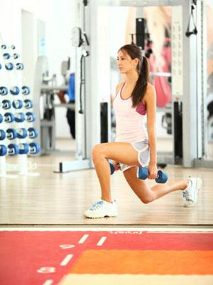 """<div class=""""caption-credit""""> Photo by: Getty Images/iStockphoto</div><div class=""""caption-title"""">Reverse Lunge</div>Stand with your feet hip width apart and chest up. Hold dumbbells* at your sides, palms facing in. Step back with your right leg, and when it hits the ground, squeeze your glutes and descend into a lunge. Bend your front left leg while dropping your back knee almost to the ground. Return to starting position; repeat with your left leg in back. Do four sets of six to eight lunges, alternating legs. <br> <br> Targets: Glutes, Quads, Hamstrings & Adductors <br> <br> *Choose a dumbbell weight that makes you feel challenged (around 10-25-pounds for most women). By the end of the set, you should feel that you could have only gotten out one or two more quality reps. <br> <br> <b>Related: <a rel=""""nofollow"""" href=""""http://www.cosmopolitan.com/advice/health/drop-5-pounds-in-a-week-0509?link=emb&dom=yah_life&src=syn&con=blog_cosmo&mag=cos"""" target=""""_blank"""">Drop 5 Pounds in a Week</a></b> <br> <b>Related: <a rel=""""nofollow"""" href=""""http://www.cosmopolitan.com/advice/health/right-way-to-lose-weight?link=emb&dom=yah_life&src=syn&con=blog_cosmo&mag=cos"""" target=""""_blank"""">The Right Way to Lose Weight</a></b>"""