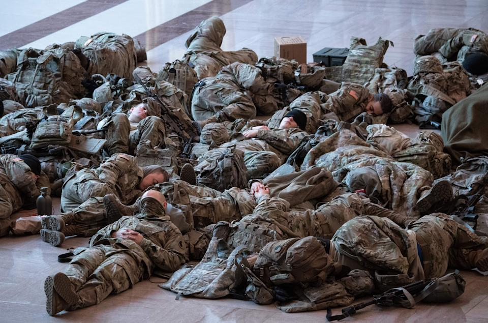 Members of the National Guard rest in the Capitol Visitors Center on Capitol Hill in Washington, DC, January 13, 2021, ahead of an expected House vote impeaching US President Donald Trump. - The Democrat-controlled US House of Representatives on Wednesday opened debate on a historic second impeachment of President Donald Trump over his supporters' attack of the Capitol that left five dead.Lawmakers in the lower chamber are expected to vote for impeachment around 3:00 pm (2000 GMT) -- marking the formal opening of proceedings against Trump. (Photo by SAUL LOEB / AFP) (Photo by SAUL LOEB/AFP via Getty Images) (Photo: SAUL LOEB via Getty Images)